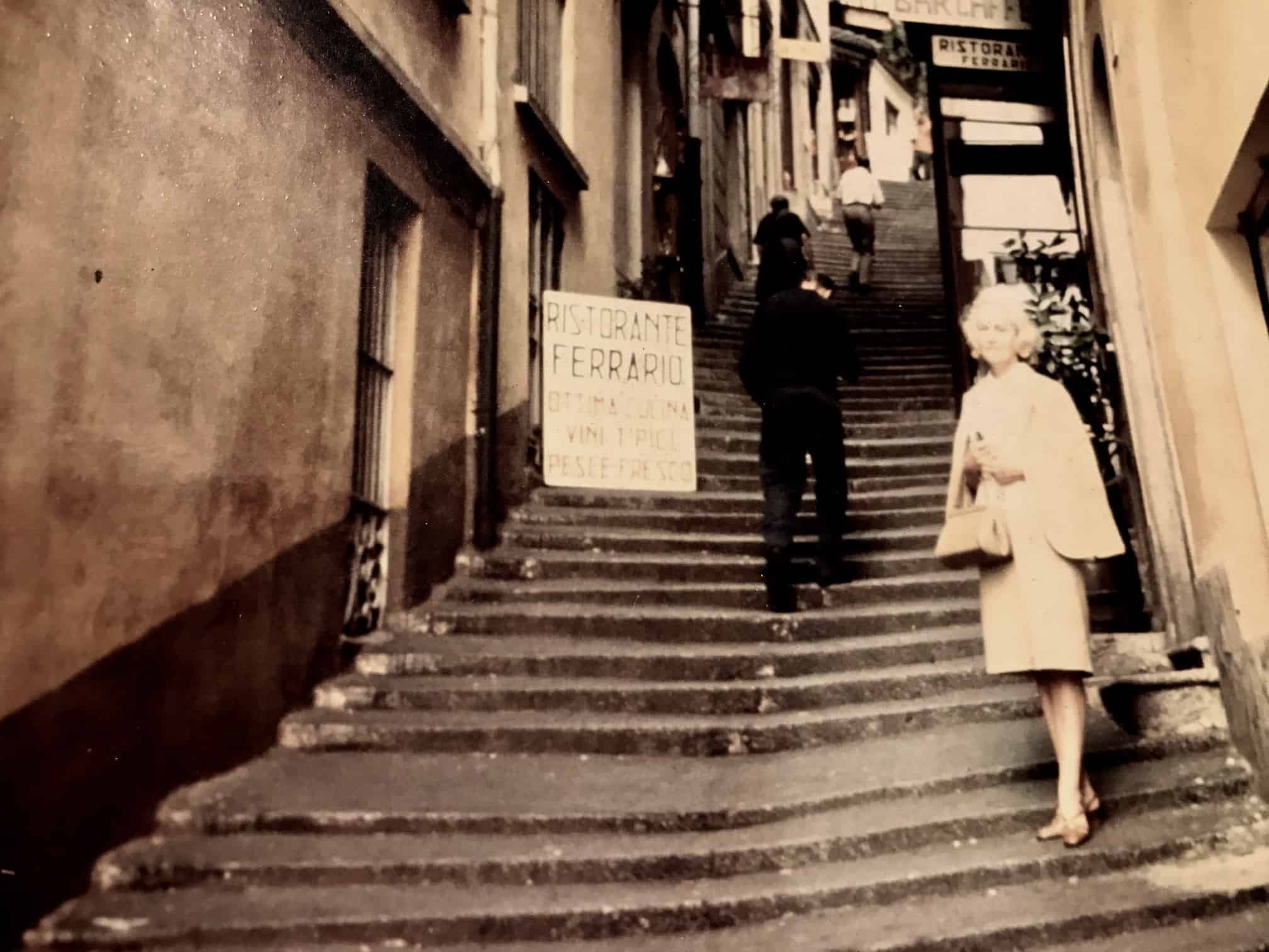 My Grandmother in Italy in the 1950's on the steps outside a restaurant.