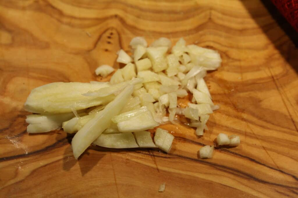 Slice garlic thinly in one direction