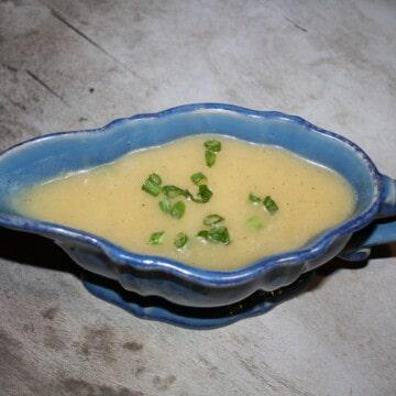 gravy in a blue saucer