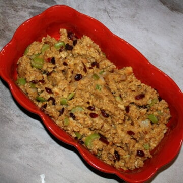 Easy Waldorf Cornbread Stuffing in a red dish