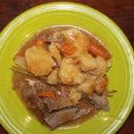 Pot Roast on a green plate.