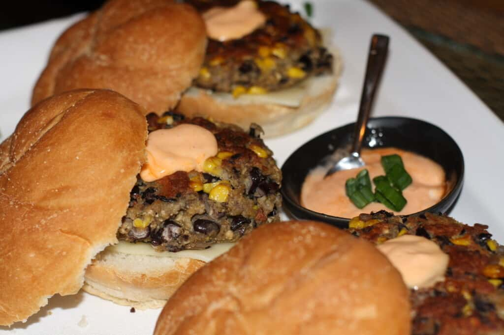 Black bean veggie burgers served in a bun with chilpote mayo