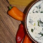 Feta Cream Cheese Alfredo Sauce on a bowl with peppers