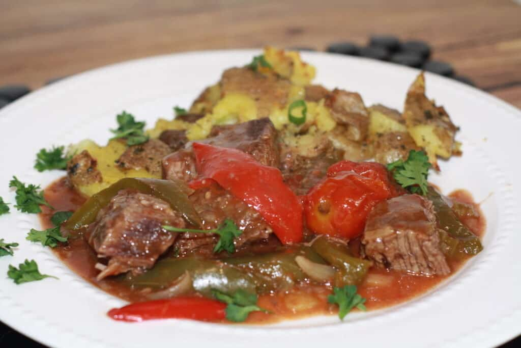 Best Savory Swiss Steak Creole served with Smashed Baby Potatoes