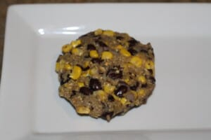 A veggie burger pattie ready for frying in the pan.