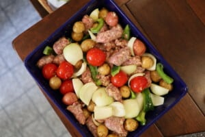 Oven Sausage Onion and Pepper in a blue casserole dish