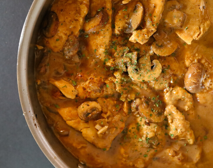 Easy Chicken Marsala in a sauce pan ready to serve over pasta.