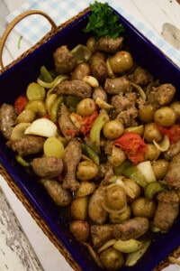 Oven Sausage Onion and Pepper recipe i a casserole pan