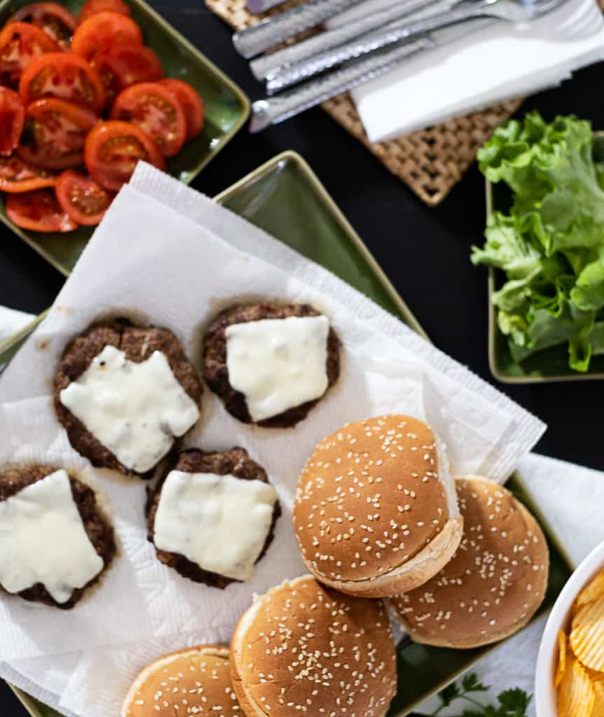 Oven broiled hamburgers ready to serve with all the fixings!