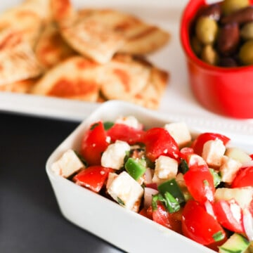 Mediterranean Greek Salad Dip with pita and olive over to the side