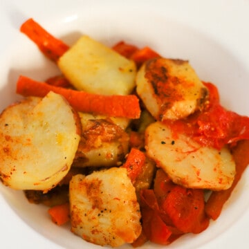 potatoes and carrots recipe pan fried in a white bowl