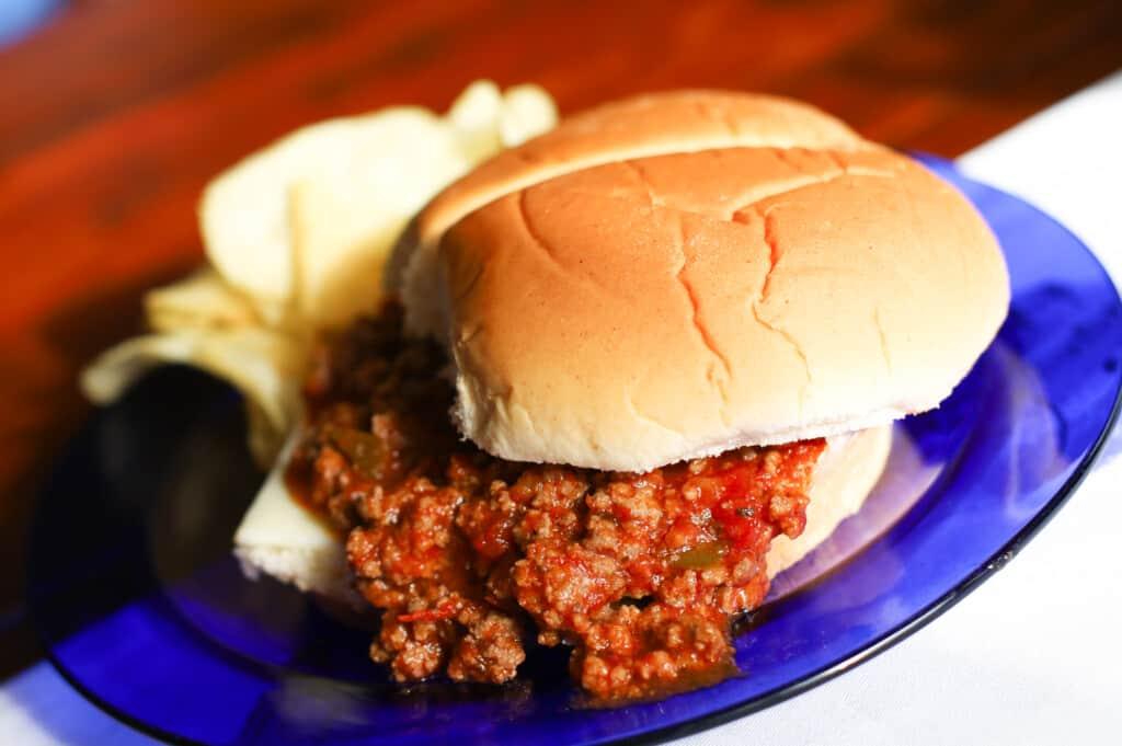 Sloppy Joes made from scratch on a roll with chips on the side.