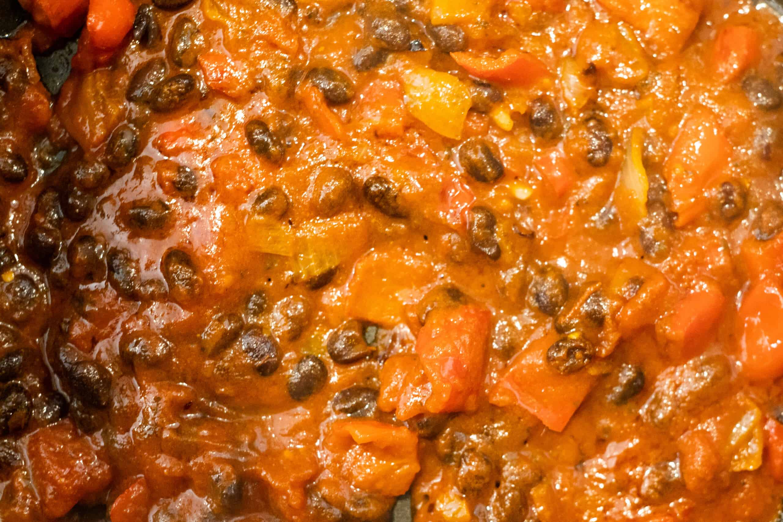 easy Spanish Rice sauce simmering in a skillet